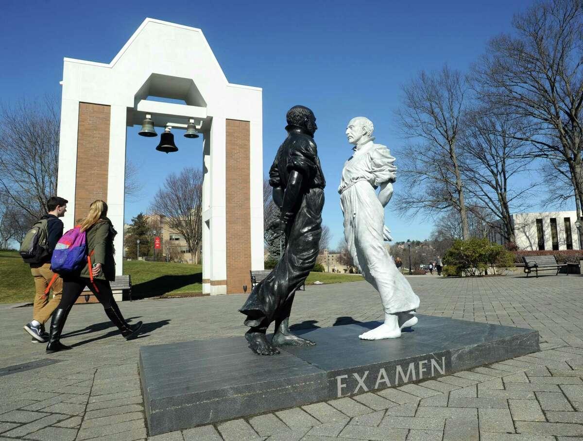 The two-part sculpture of St. Ignatius at the Egan Chapel of St. Ignatius Loyola plaza on Fairfield University's campus in Fairfield.
