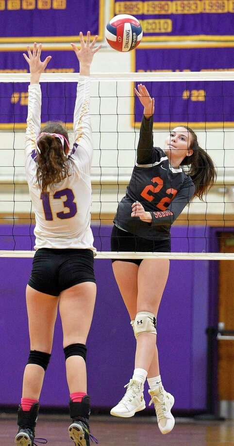Ridgefield's Catherine Maguire spikes the ball past Westhill's Betsy Sachs (13) in a varsity girls volleyball match on Wednesday, Oct. 24, 2018 in Stamford, Connecticut. Photo: Matthew Brown / Hearst Connecticut Media / Stamford Advocate