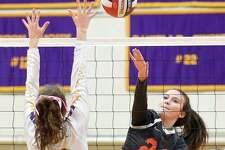 Ridgefield's Catherine Maguire spikes the ball past Westhill's Betsy Sachs (13) in a varsity girls volleyball match on Wednesday, Oct. 24, 2018 in Stamford, Connecticut.