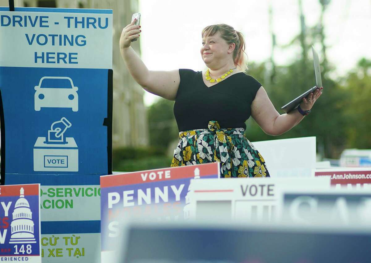 Sara Cress, runs the Twitter account for the Harris County Clerk/Harris Votes outside a voting location in Houston on Tuesday, Oct. 20, 2020.