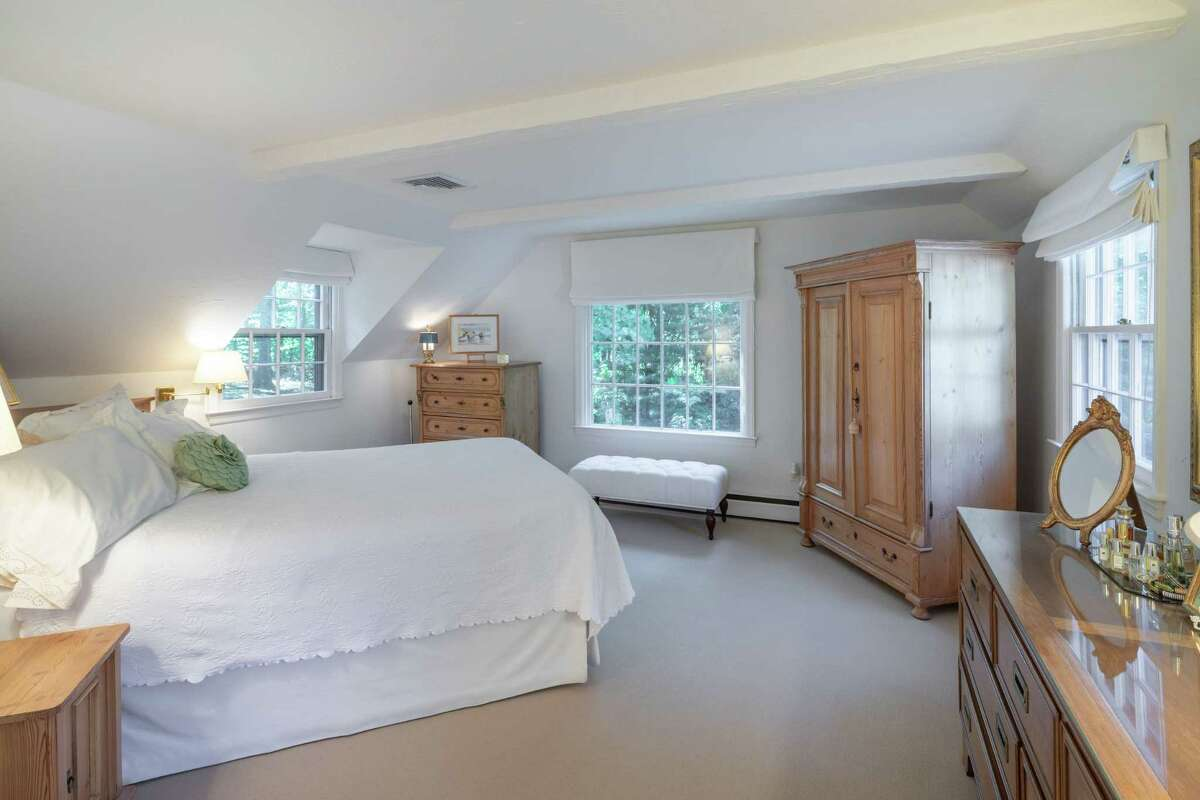 The master bedroom suite has a sitting area, wall-to-wall wool carpeting, walk-in closet, and recently renovated marble bath with a radiant heated floor.