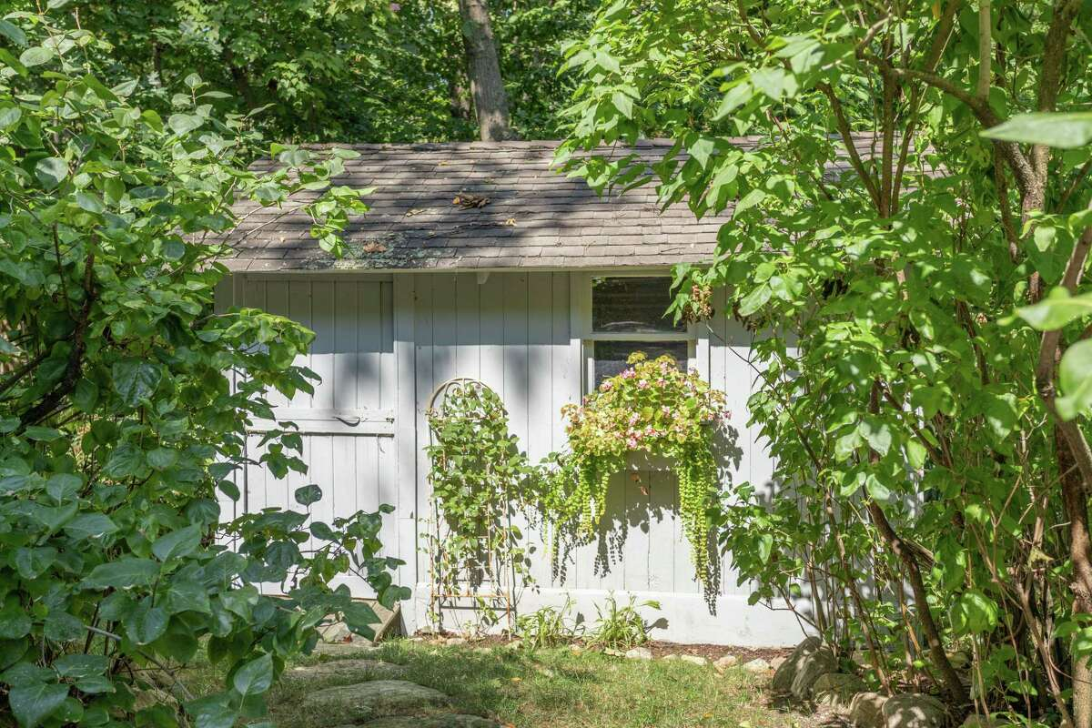 A charming tool shed could be converted into a potting shed.