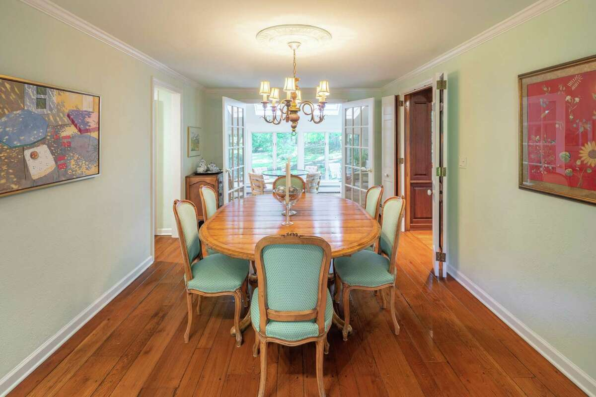 There are two sets of French doors in the formal dining room; one to the kitchen and the other to the sun room.