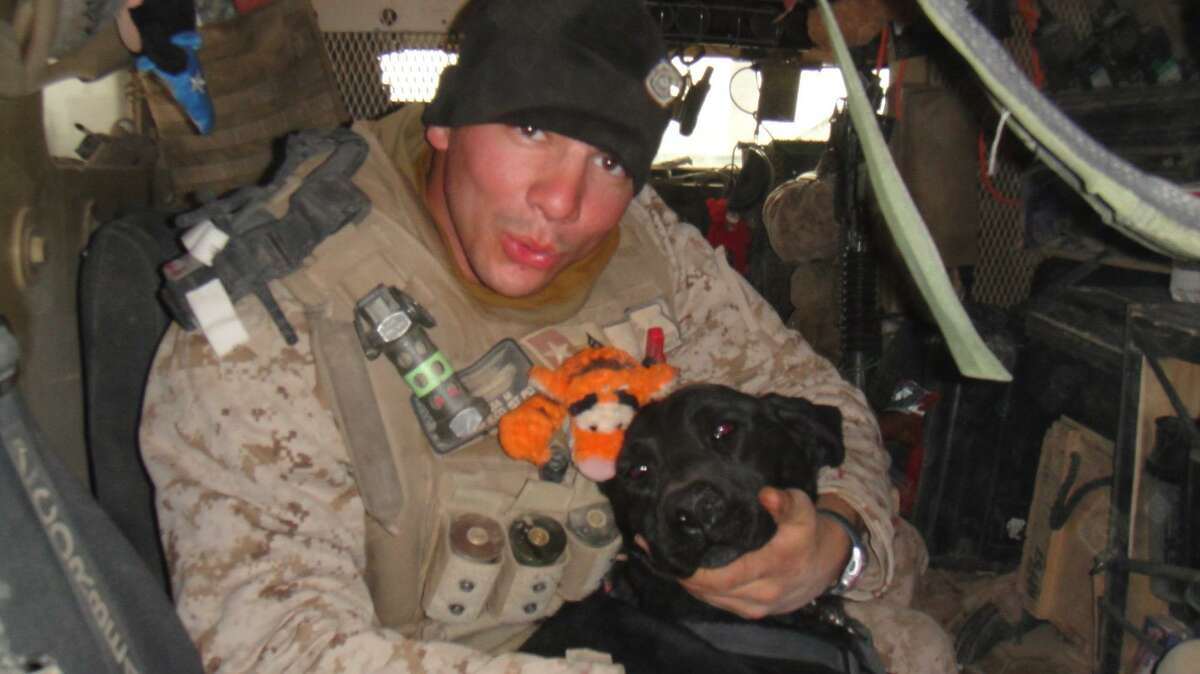 Dillonger Hackett is seen while deployed overseas. He is suing his accusers after sexual assault charges against him were dropped this month.