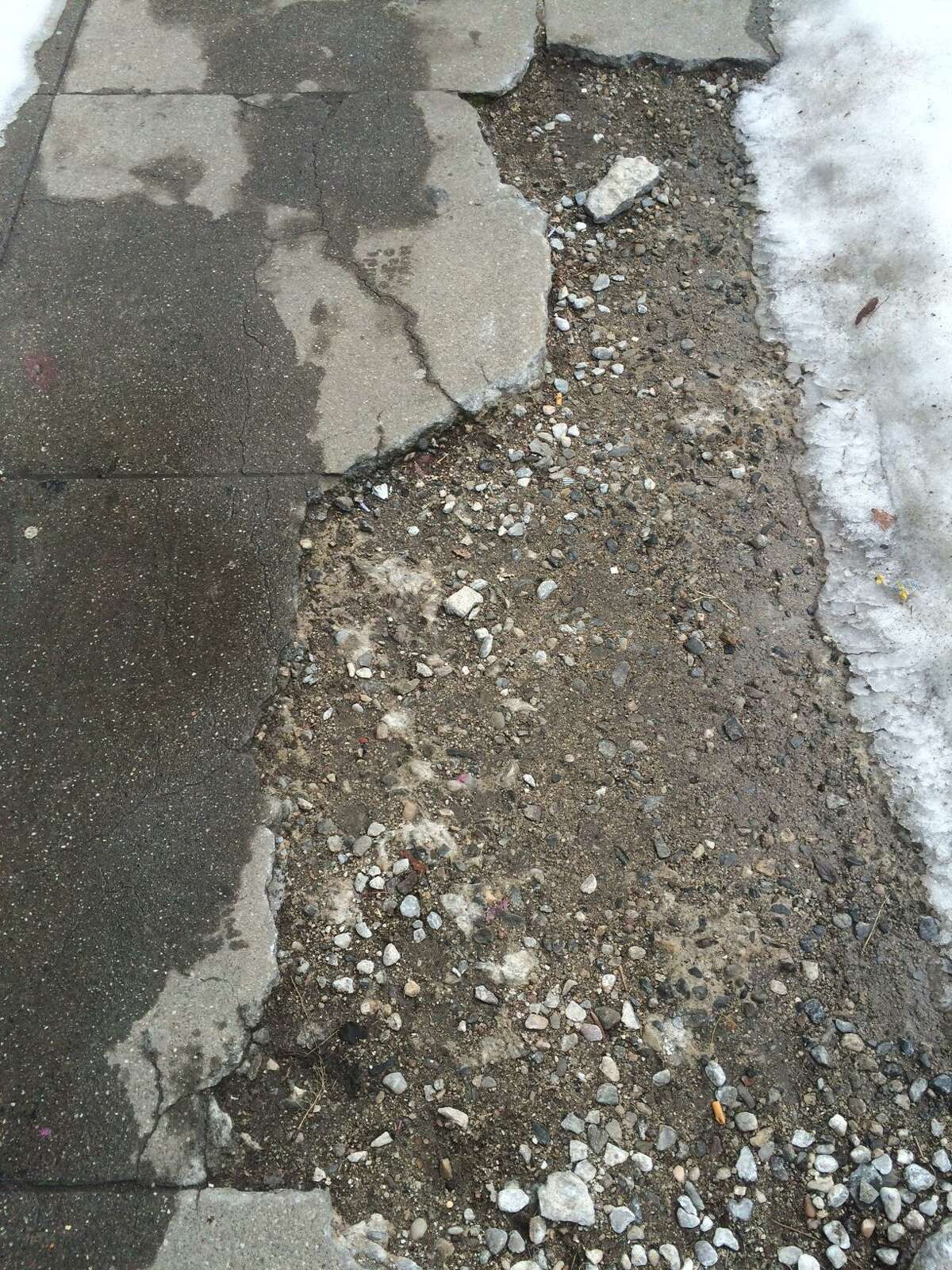 Cracked and damaged sidewalks along Main St. in Bridgeport, Conn. Jan. 29. 2016.