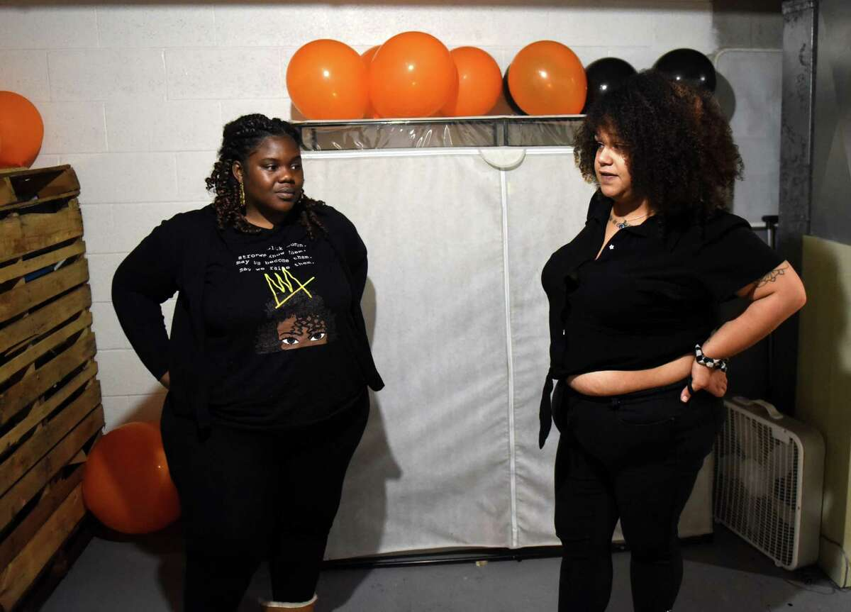 Janelle Brandon, left, and Shalonda Faircloth, right, of Schenectady are pictured in Faircloth's basement where they have created a virtual online store to provided for community members in need on Wednesday, Oct. 21, 2020, in Schenectady, N.Y. Their store, 518 Free Store, offers free items, ranging from toothpaste to laundry detergent to diapers to needy people. They take orders on Mondays and make deliveries on Wednesday. (Will Waldron/Times Union)