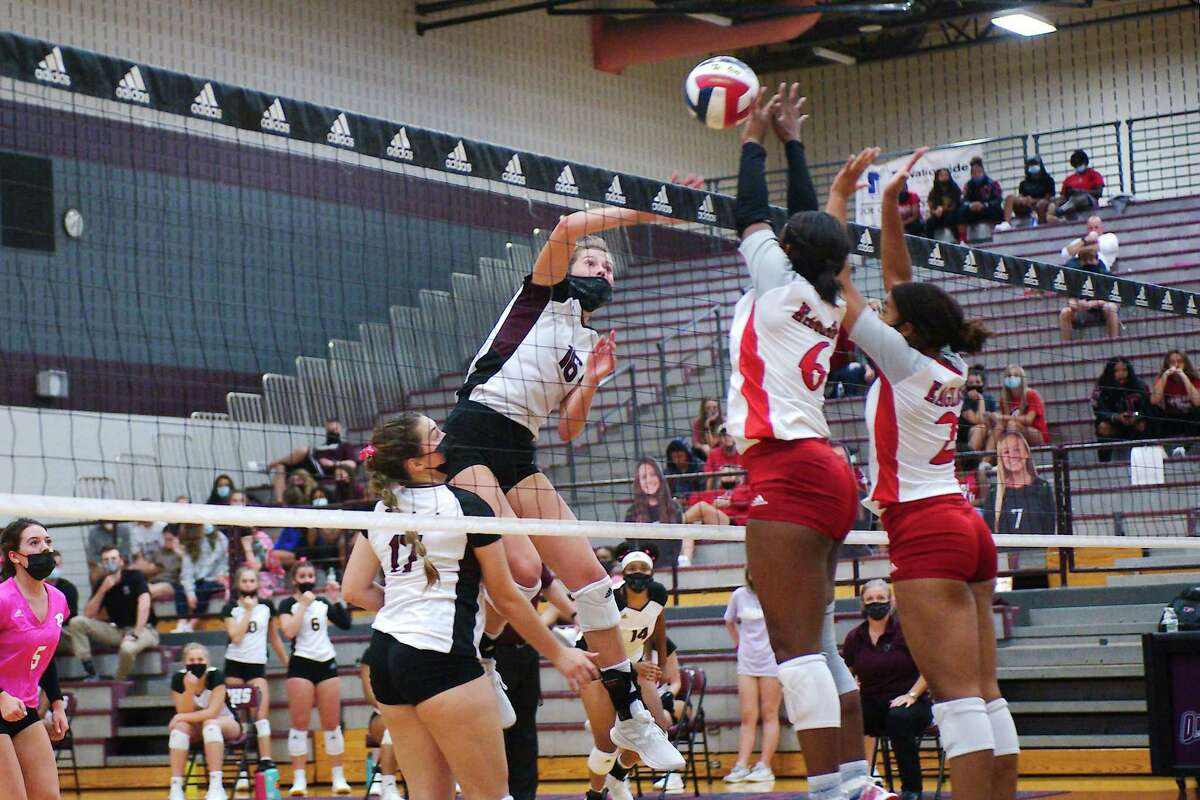 Pearland's Ava Scott (16) tries to hit past Dawson's Alexia Jones (6) and Sydney Alexander (2) Tuesday, Oct. 13 at Pearland High School.