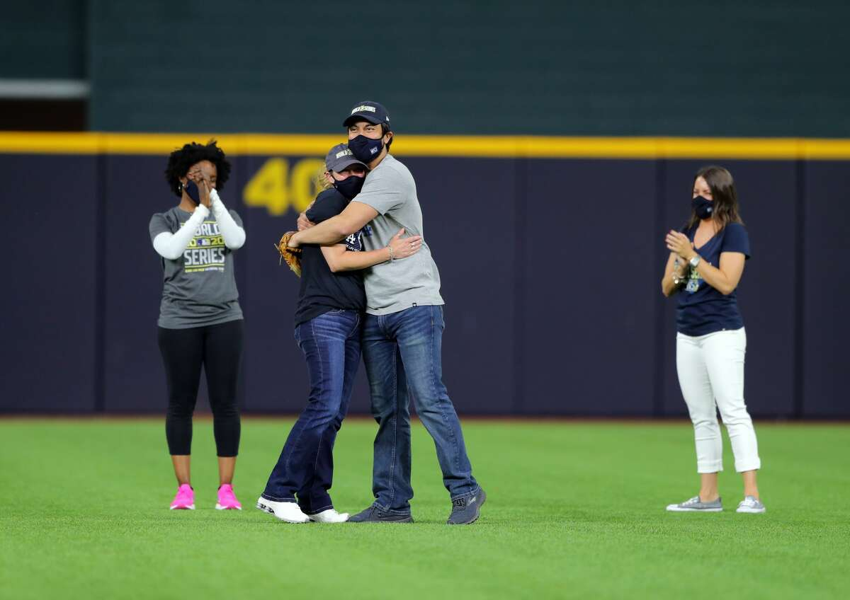 Edens and Ward, who are married, tossed out the pitch as Burns and Combs stood beside them.