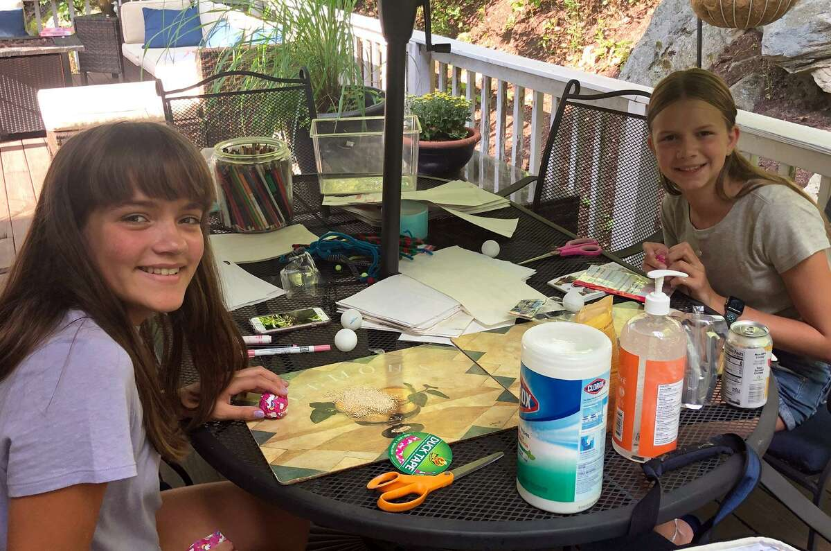 NCL Nutmeg members Brenna Williams and Siri Sobocinski making toys for R.O.A.R.