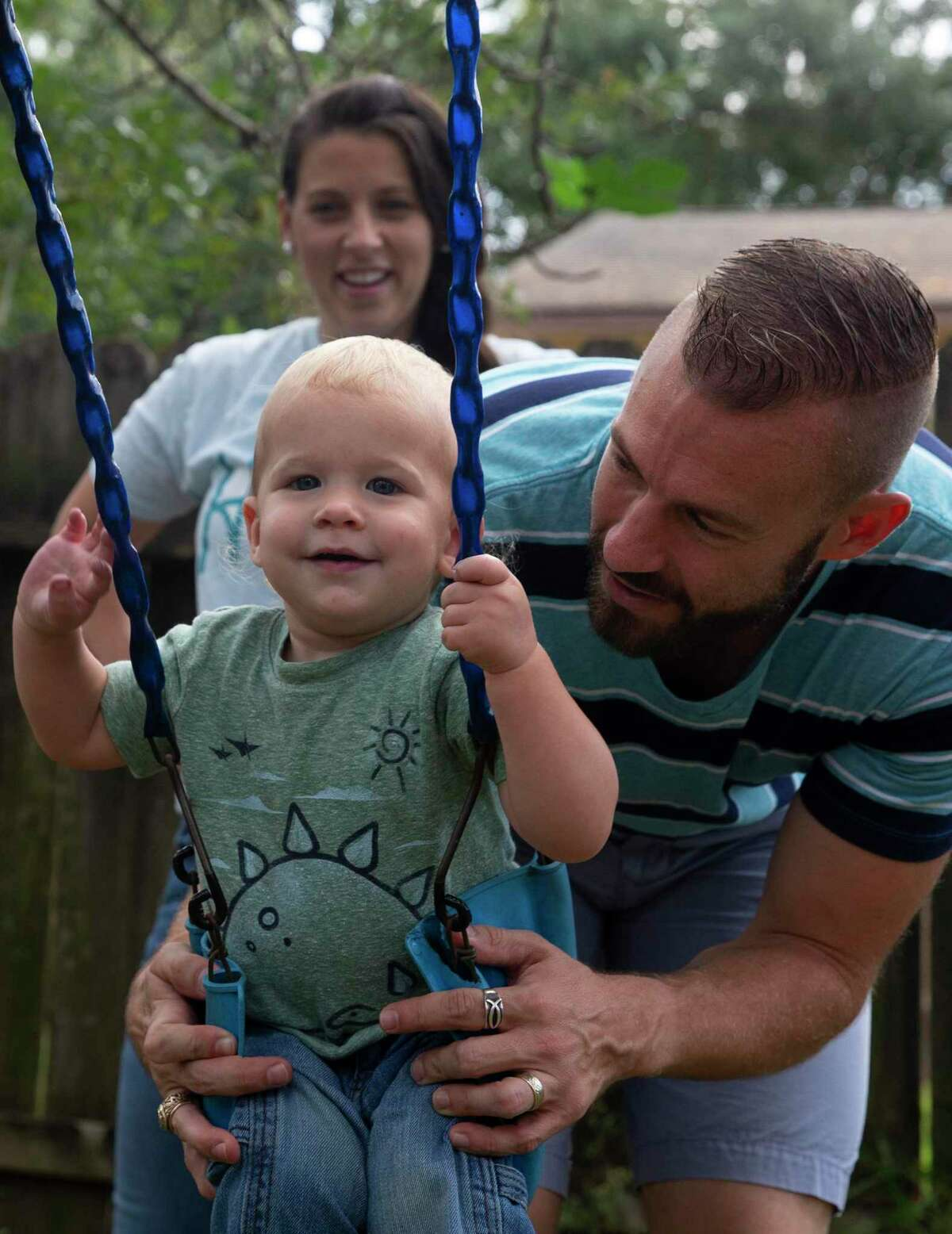 Matt Nyert, 35, helps his son, Zeke, 1, play swing in the family backyard Thursday, Oct. 15, 2020, in Spring. Hillary Nyert, 36, and Matt lost their daughter, Kate, in 2017 when Hillary was at 37 weeks pregnancy. They now have two children, Zoë, 4, and Zeke.