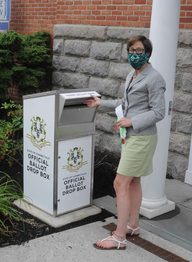 Town Clerk Wendy Lionetti shows off the ballot drop box on Bailey Avenue near a side entrance to town hall. Photo: Macklin Reid / Hearst Connecticut Media