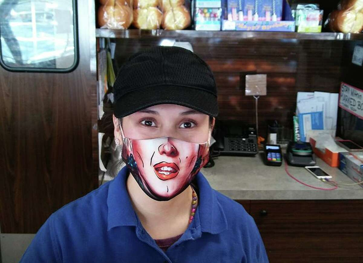 A deli employee in Stamford with an artistic mask.
