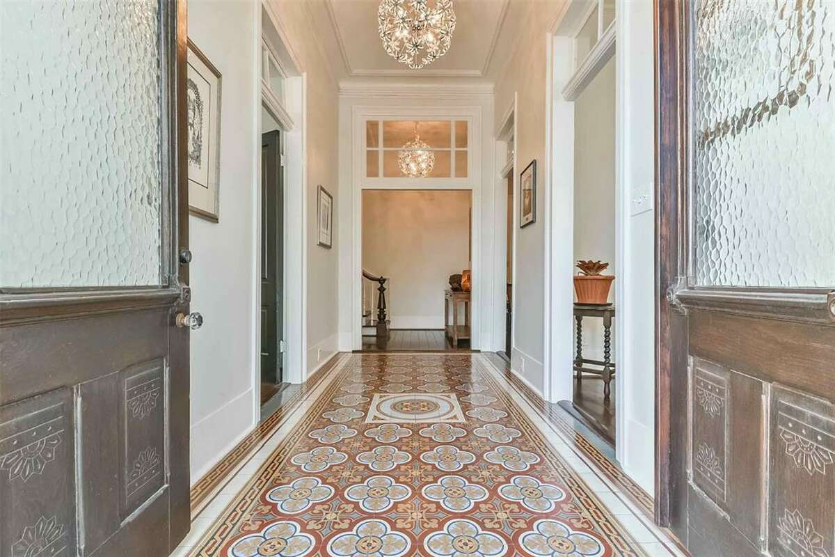 The stunning entryway includes the original tile.