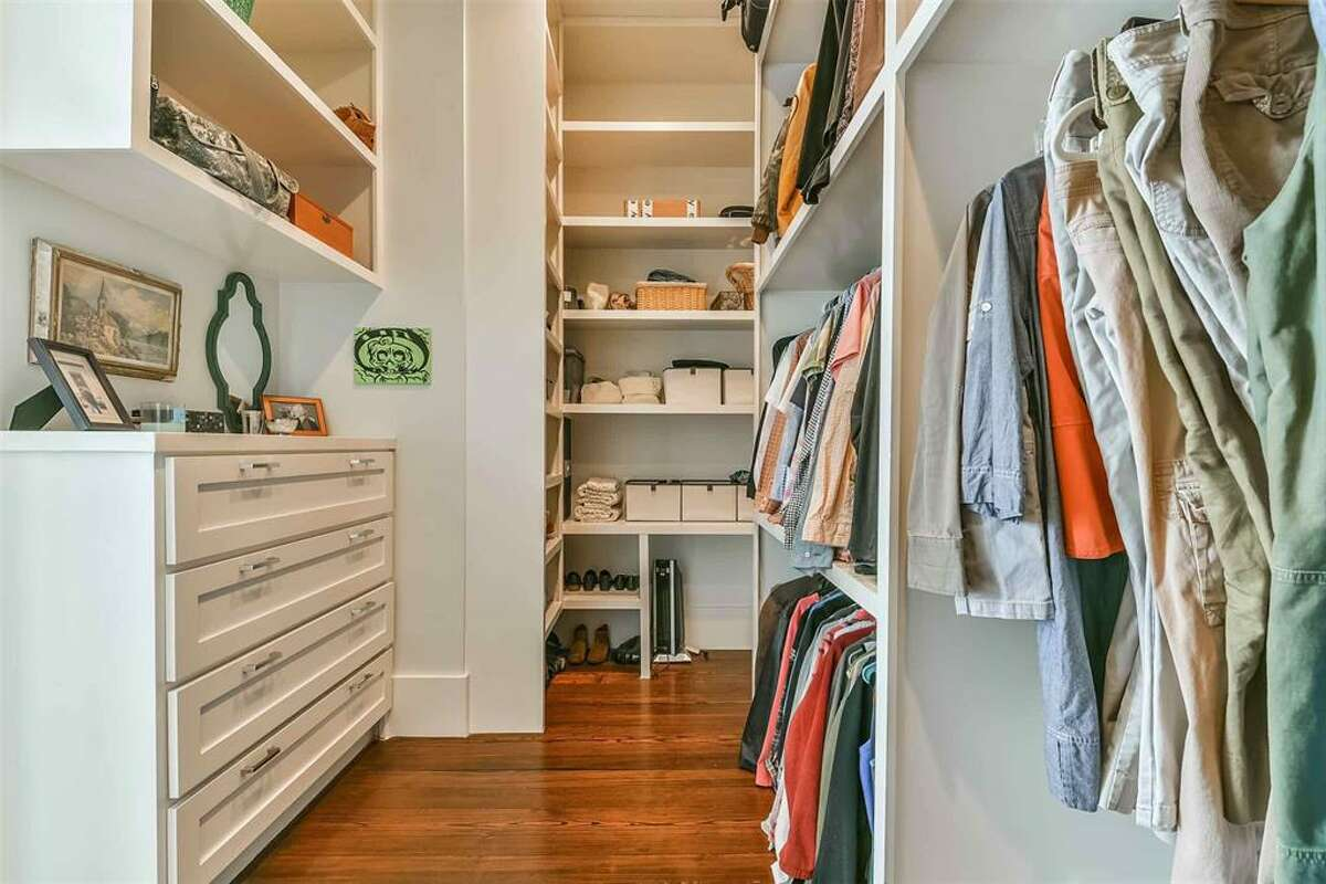 The huge closet comes with wood floors and plenty of storage space.