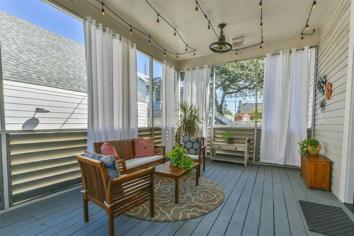 A screened-in porch is just one of the many stand-out features of the home.