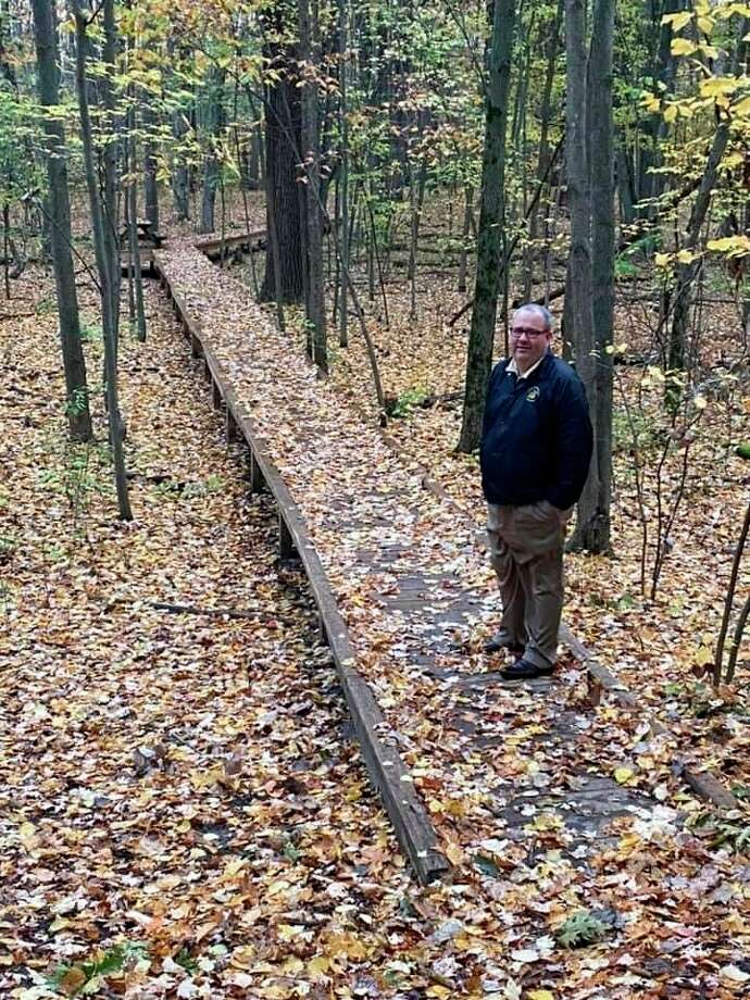 Recently retired Floyd Elementary School Principal Rod Dishawstands on the school'snature trail on a new boardwalk that was built by Trinseo. (Photo provided/Rod Dishaw)