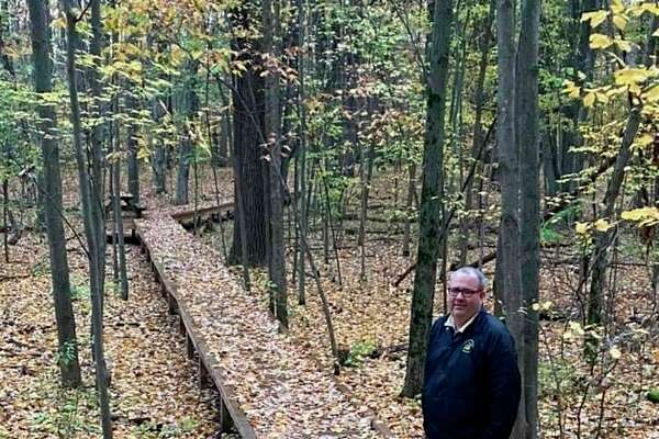 Recently retired Floyd Elementary School Principal Rod Dishaw stands on the school's nature trail on a new boardwalk that was built by Trinseo. (Photo provided/Rod Dishaw)