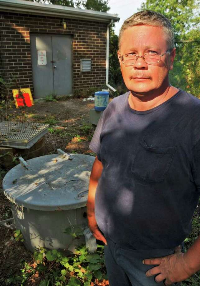 Edsel Place resident Kevin Burlingame is among those concerned about the sewage leaking from a Cohoes pump station.   (John Carl D'Annibale / Times Union) Photo: John Carl D'Annibale
