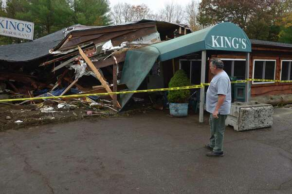 Nick Pirraglia surveys the damage to the restaurant he owns with his son, Dan Pirraglia, the morning after a tractor-trailer crashed into King's Breakfast & Lunch at 271 South Main St. Wednesday, October 21, 2020, in Newtown, Conn.Pirraglia said it was the third time it has happened since they purchased the restaurant eight years ago.