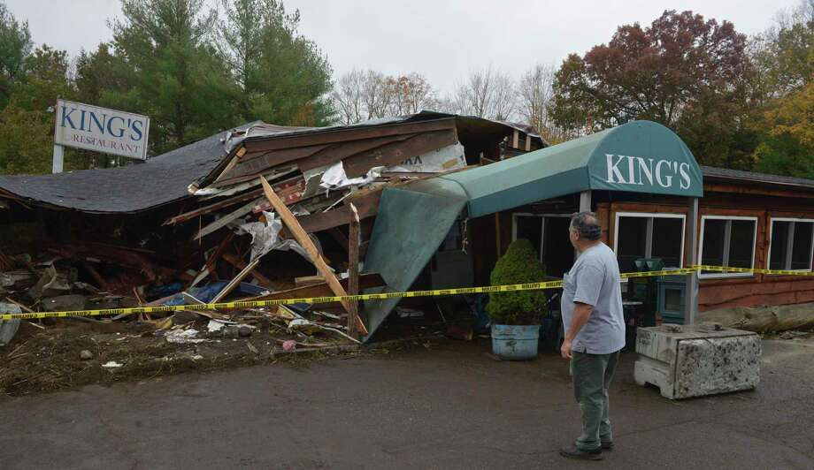 Nick Pirraglia surveys the damage to the restaurant he owns with his son, Dan Pirraglia, the morning after a tractor-trailer crashed into King's Breakfast & Lunch at 271 South Main St. Wednesday, October 21, 2020, in Newtown, Conn.Pirraglia said it was the third time it has happened since they purchased the restaurant eight years ago. Photo: H John Voorhees III / Hearst Connecticut Media / The News-Times