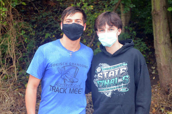 Father McGivney senior cross country runners Andrew Dupy, left, and Tanner went on a mission trip to Topeka, Kansas in July 2019. A trip to West Virginia was canceled this summer due to the coronavirus, but they hope to go on a mission to Grand Rapids, Michigan, next summer.