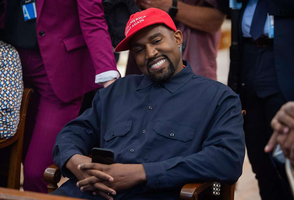 Kanye West, shown during a 2018 meeting with President Trump, has always expressed elements of politics in his music. But his political actions of late are not connecting with fans in the same way, says Chronicle columnist Justin Phillips.