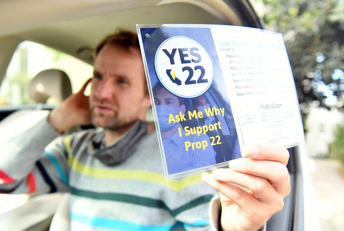"""Uber driver Sergei Fyodorov discusses why he supports a """"yes"""" vote on Proposition 22 in Oakland on Oct. 9, 2020. The ballot measure passed in Tuesday's election."""