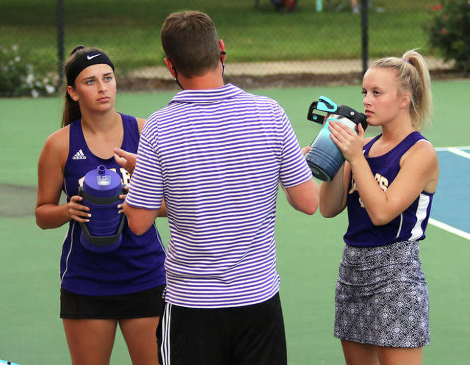 CM seniors Hannah Butkovich (left) and Kennedy Loewen (right) listens to instruction from Eagles coach Matt Carmody during their girls tennis doubles match against Jersey on Sept. 16 at Moore Park's Simpson Tennis Center in Alton. Butkovich and Loewen finished their prep career as two-time state qualifiers. Photo: Greg Shashack | The Telegraph