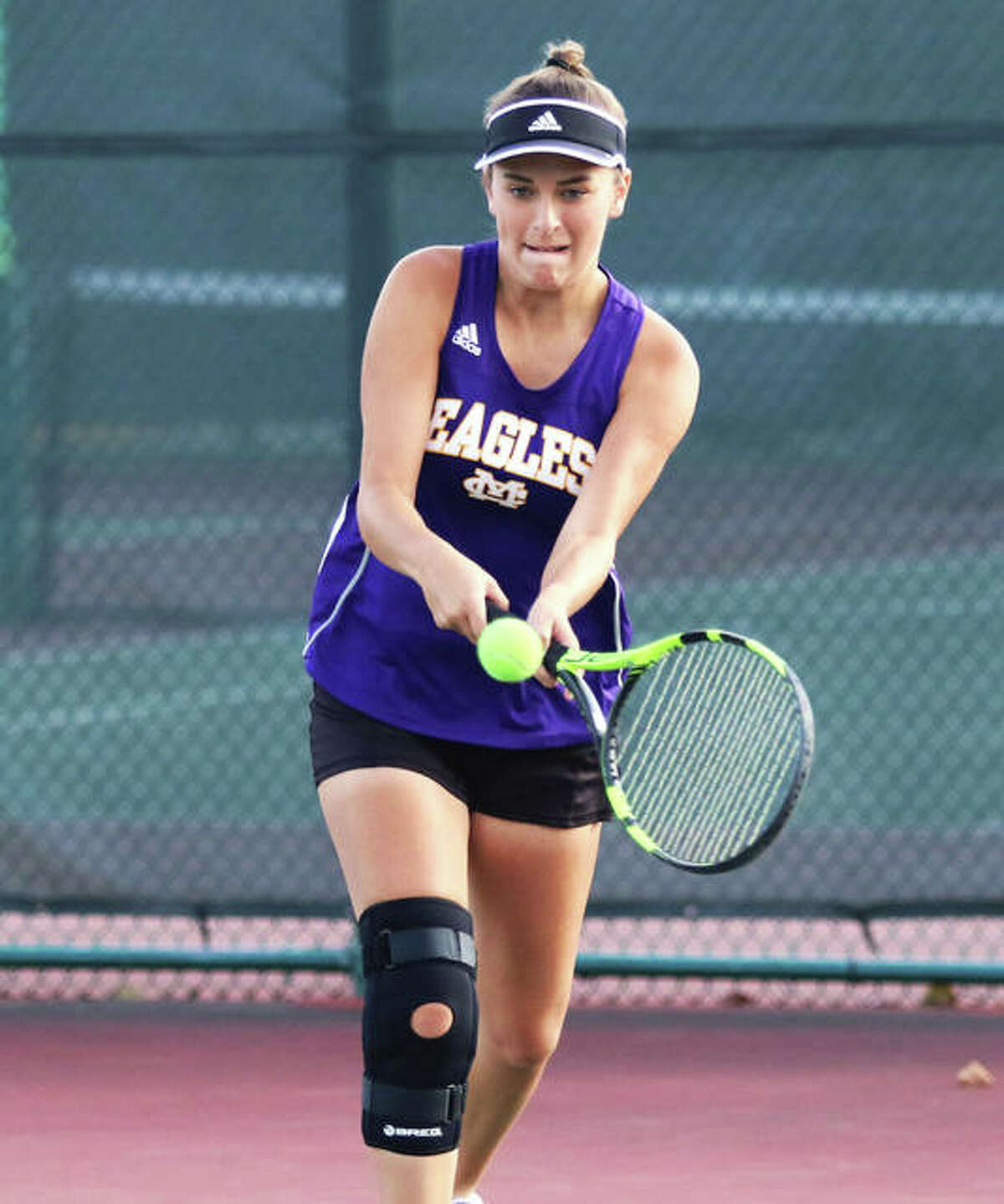 CM's Hannah Butkovich hits a backhand during a Robert Logan Invitational doubles match at Triad High School in Troy.
