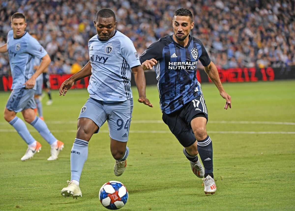 KANSAS CITY, KS - MAY 29: Sebastian Lletget #17 of Los Angeles Galaxy goes for the ball against Jimmy Medranda #94 of Sporting Kansas City during the first half on May 29, 2019 at Children's Mercy Park in Kansas City, Kansas. (Photo by Peter G. Aiken/Getty Images)