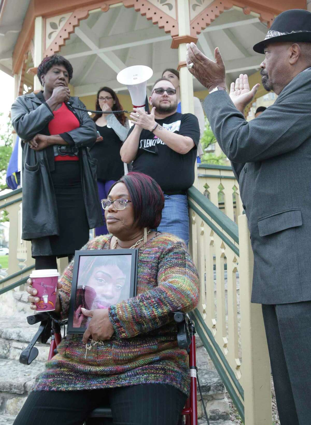 Speaker Monica Roberts is applauded by Rev. Dr. William H. Knight with JoAnn McFadden listening as LGBTQ community members take part in a rally in Crockett Park to demonstrate their solidarity and support for justice for Kenne McFadden on March 13, 2018.