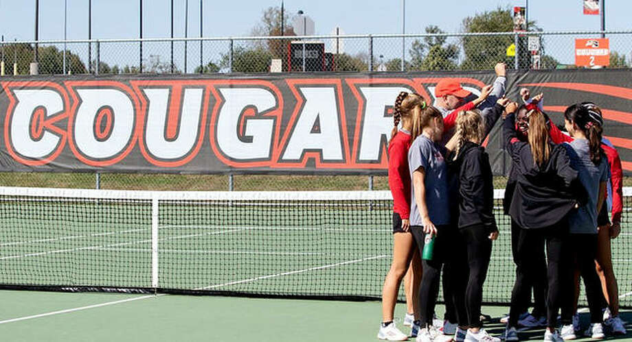 The SIUE tennis team gets together following a practice. Nearly two dozen Cougar student-athletes come to SIUE from outside of the United States to play the sport they love and receive an unparalleled college education, but many have faced different difficulties dealing with the coronavirus pandemic in the native countries. Photo: SIUE Athletics