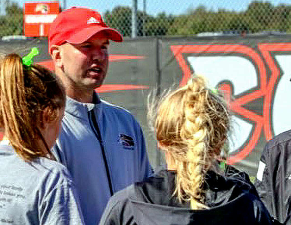 SIUE tennis coach Adam Albertsen speaks with members of his team.
