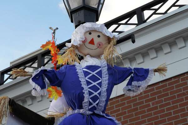 Nearly 100 scarecrows are hung on lamp posts around the village of New Canaan for the fourth annual Scarecrow Fest, presented by the Young Women's League of New Canaan. The Project Coordinator for the town, Mimi Pitt, provides information in this guest column about how residents can observe the holiday during the coronavirus pandemic.