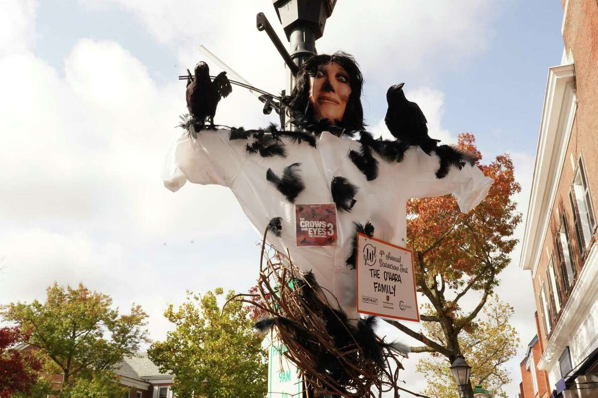 Nearly 85 scarecrows are hung on lamp posts around the village of New Canaan for the fourth annual Scarecrow Fest, presented by the Young Women's League of New Canaan.