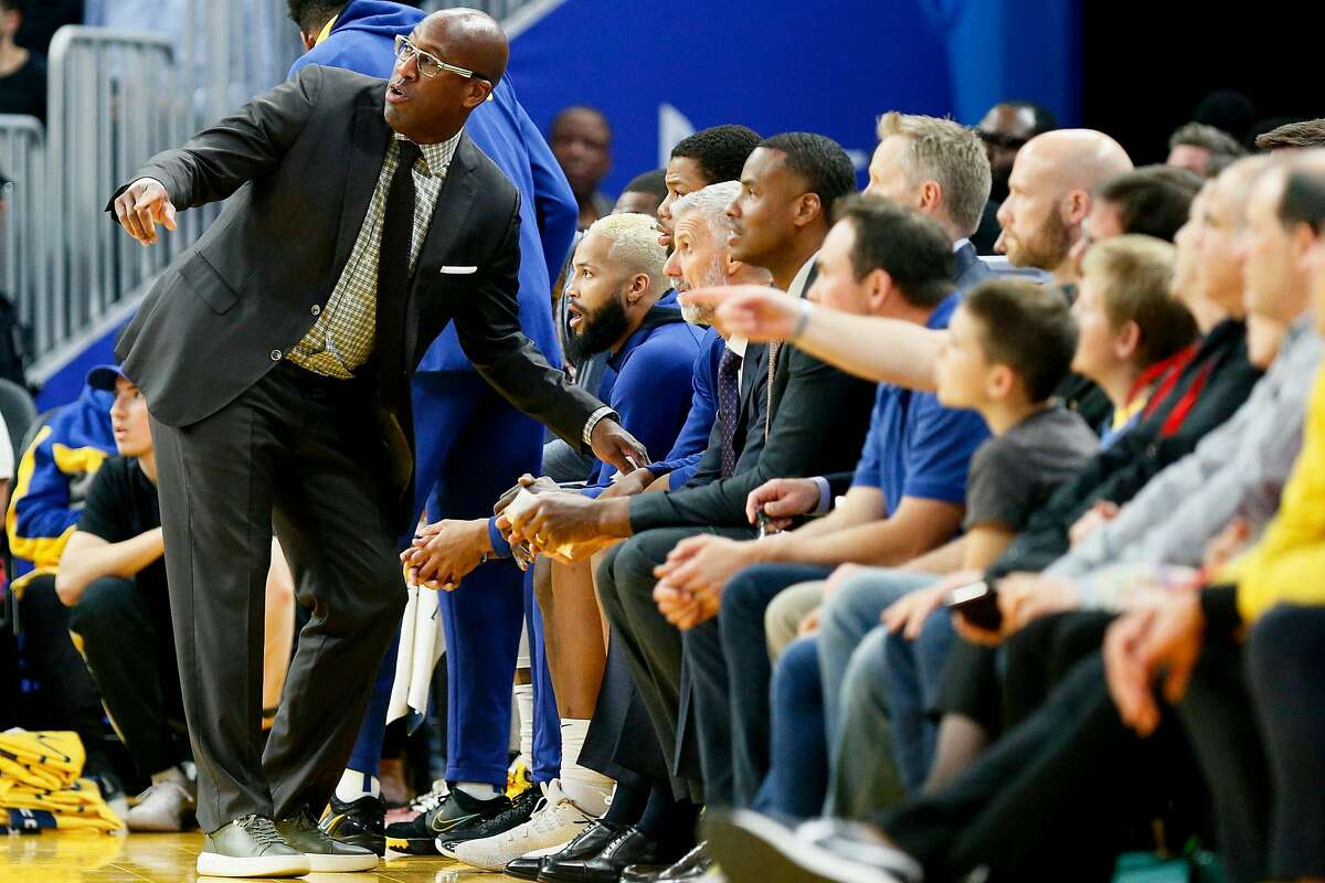 Golden State Warriors assistant coach Mike Brown talks to Warriors players on the bench in the first period of an NBA game against the Boston Celtics at Chase Center on Friday, Nov. 15, 2019, in San Francisco, Calif.