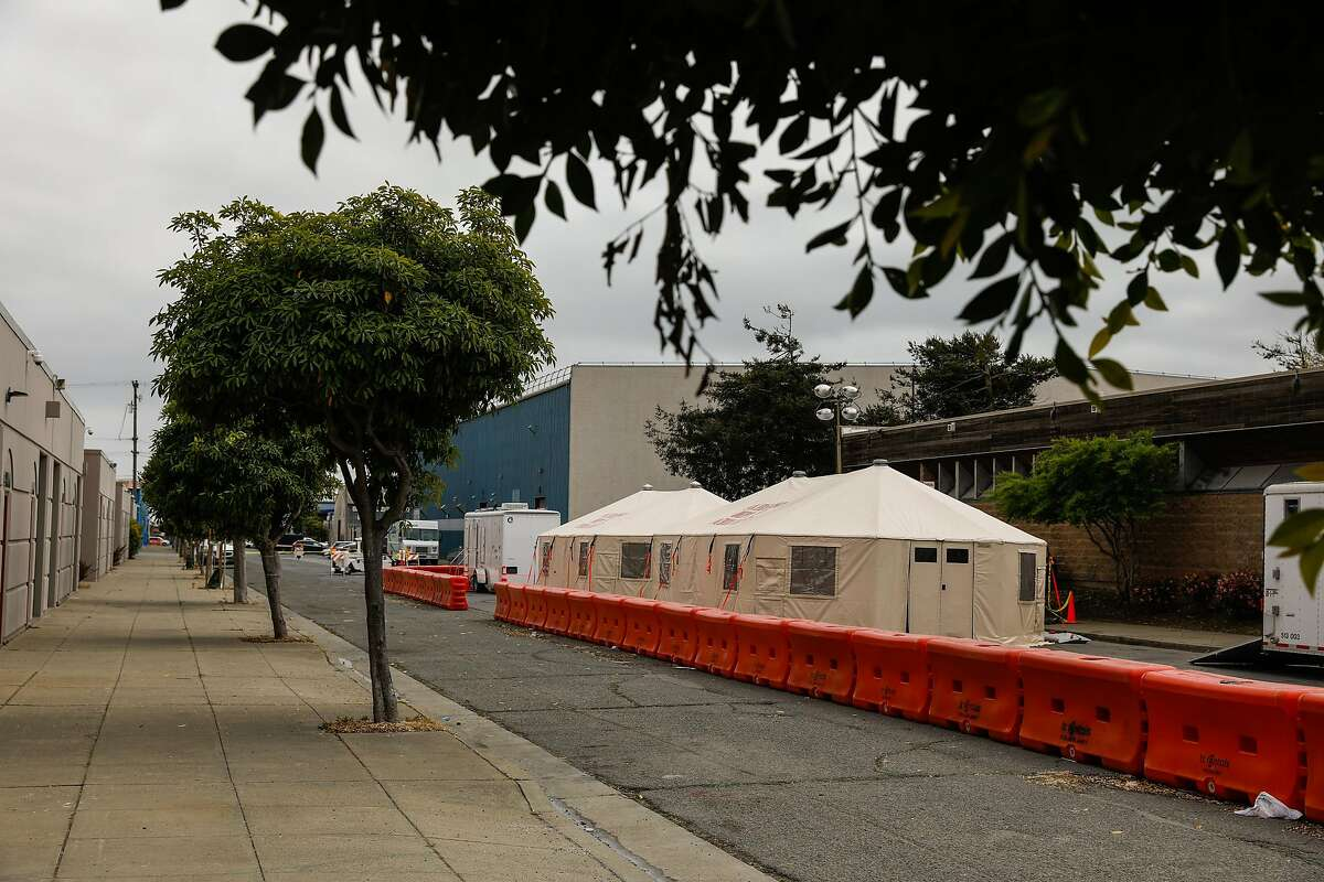 A medical tent next to the Southeast Health Center in Bayview in April. One plantiff in the suit says she was assigned to screen patients on the sidewalk but was not given a mask for protection against COVID-19.