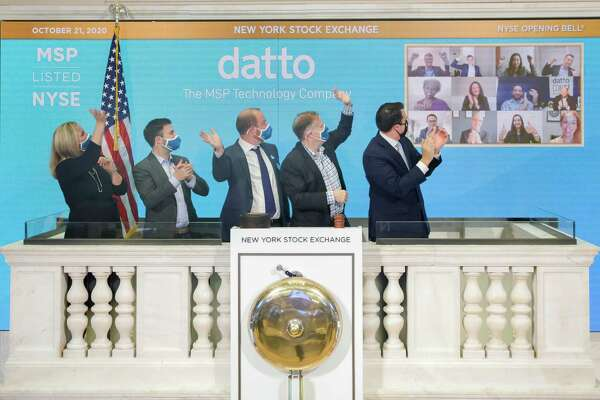 Datto founder Austin McChord and Tim Weller (center L-R) acknowledge Datto employees on a web video feed as they ring the opening bell of the New York Stock Exchange on Wednesday, Oct. 21, 2020, the day of Datto's initial public offering of stock. (New York Stock Exchange photo courtesy Datto)