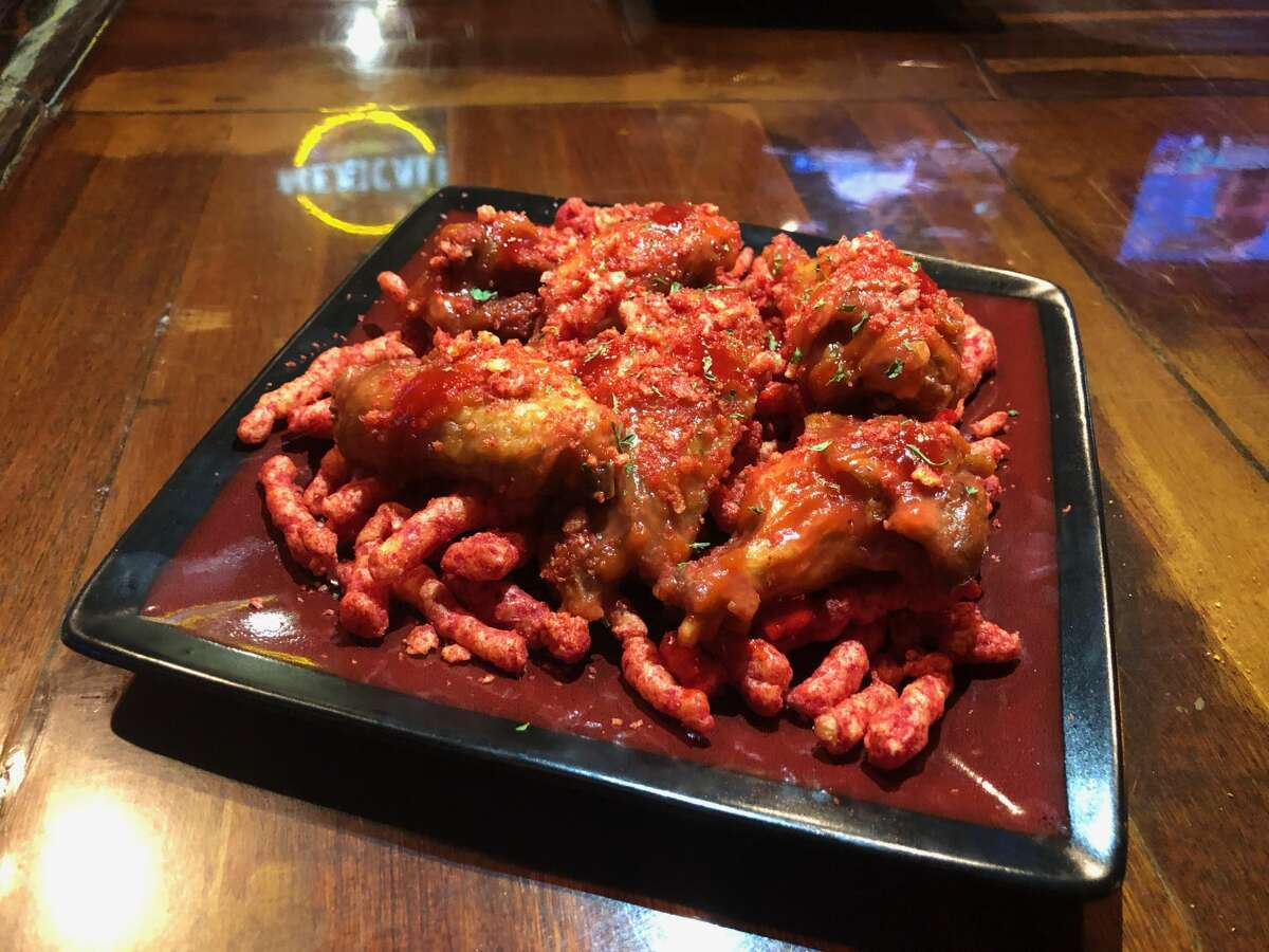 """""""It ended up being wings in a Big Red-sriracha infusion sauce served over a bed of Hot Cheetos,"""" Wilson said of the creation. """"I couldn't think of anything more San Antonio than that."""" He said once the Big Red sauce idea was cooked up, the mangonada flavor was a """"no brainer."""""""