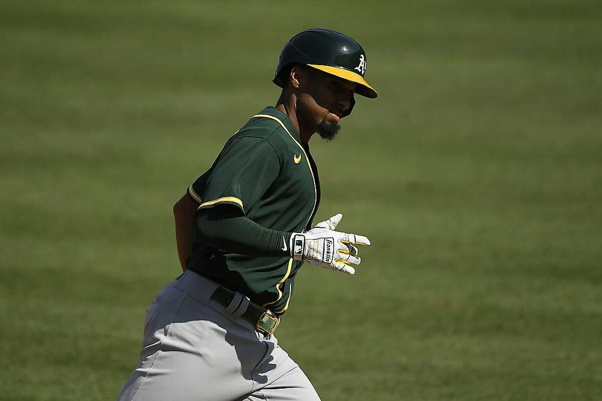 LOS ANGELES, CALIFORNIA - OCTOBER 07: Marcus Semien #10 of the Oakland Athletics rounds the bases after hitting a solo home run against the Houston Astros during the fifth inning in Game Three of the American League Division Series at Dodger Stadium on October 07, 2020 in Los Angeles, California. (Photo by Kevork Djansezian/Getty Images)