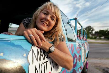 """In 2012, thieves stole Buschur's """"Make Out Not War"""" pickup from her driveway. She reclaimed it from an impound lot the next day."""