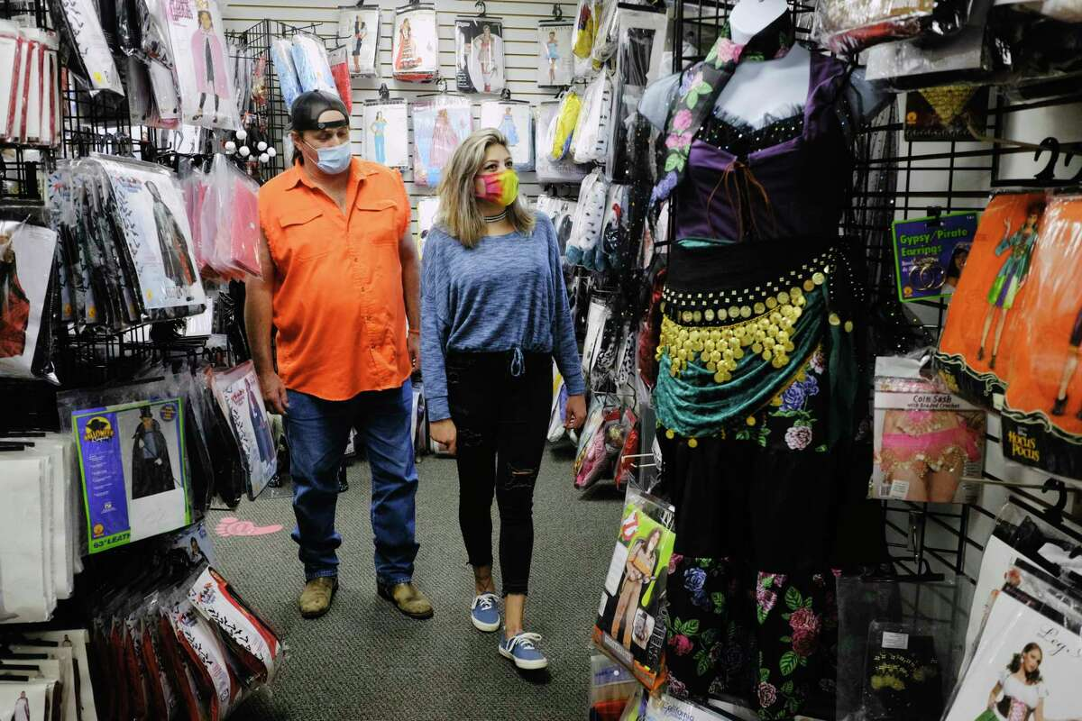Husband and wife, Rona and Kristi Edwards of Voorheesville search for Halloween costumes at The Costumer on Wednesday, Oct. 21, 2020, in Albany, N.Y. (Paul Buckowski/Times Union)