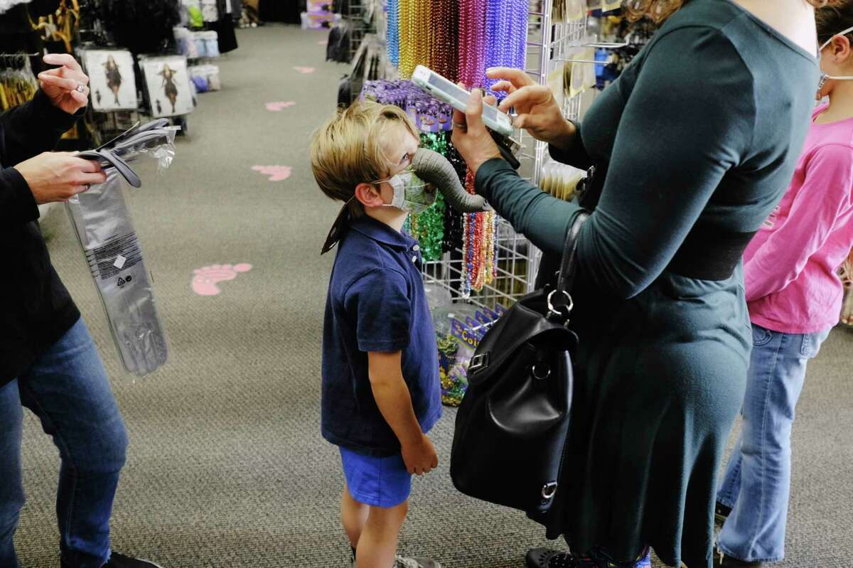 Mack Bourdon, 5, of Niskayuna wears the elephant nose his mom, Leslie Bourdon, is buying him for his Halloween costume as the family shopped at The Costumer on Wednesday, Oct. 21, 2020, in Albany, N.Y. Leslie Bourdon said that they are excited for Halloween but she and her husband are still trying to figure out what exactly Halloween will be like for them and their children. (Paul Buckowski/Times Union)
