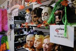 Scary masks and masks dealing with politics are seen on display at The Costumer on Wednesday, Oct. 21, 2020, in Albany, N.Y.  (Paul Buckowski/Times Union)