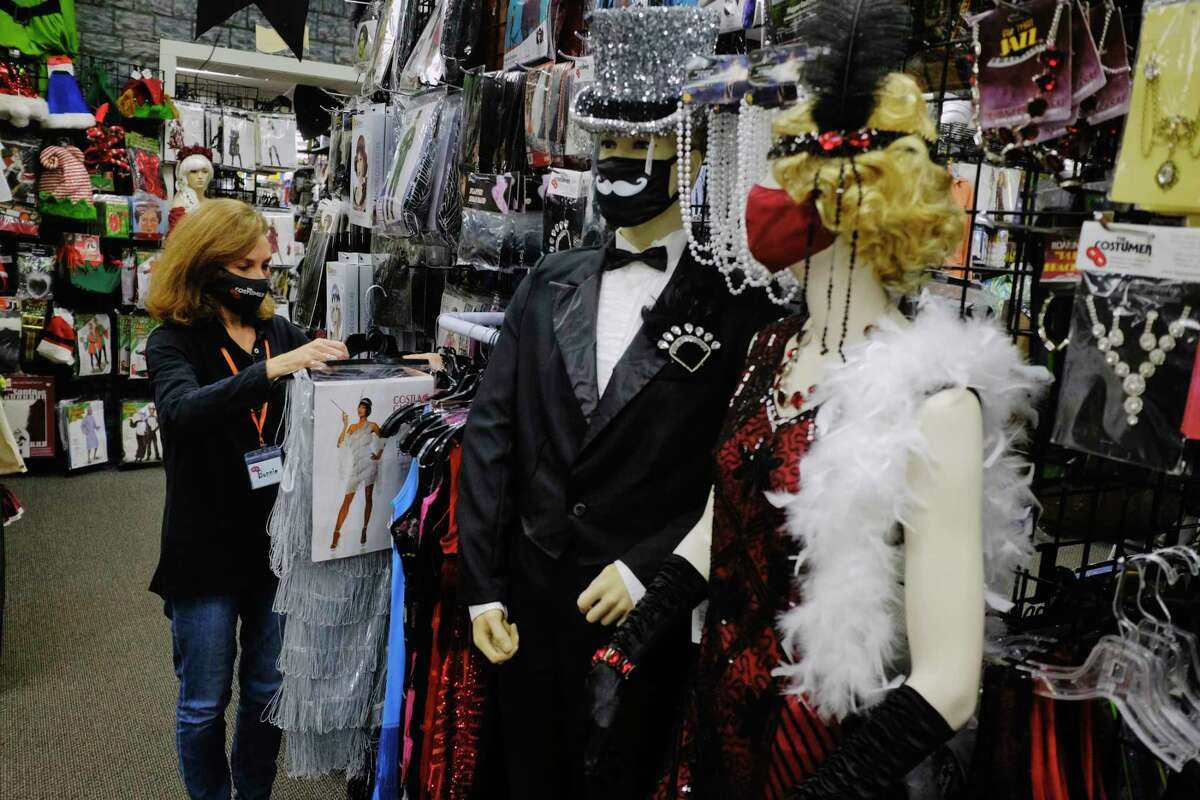 Bonnie Johnsen, who along with her husband, Erik Johnsen, owns The Costumer, works inside her store on Wednesday, Oct. 21, 2020, in Albany, N.Y. (Paul Buckowski/Times Union)