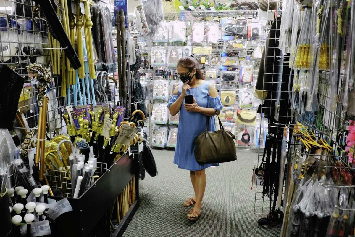 Catherine Codamon of Clifton Park searches for a scepter to use with her Medusa costume at The Costumer on Wednesday, Oct. 21, 2020, in Albany, N.Y. (Paul Buckowski/Times Union)