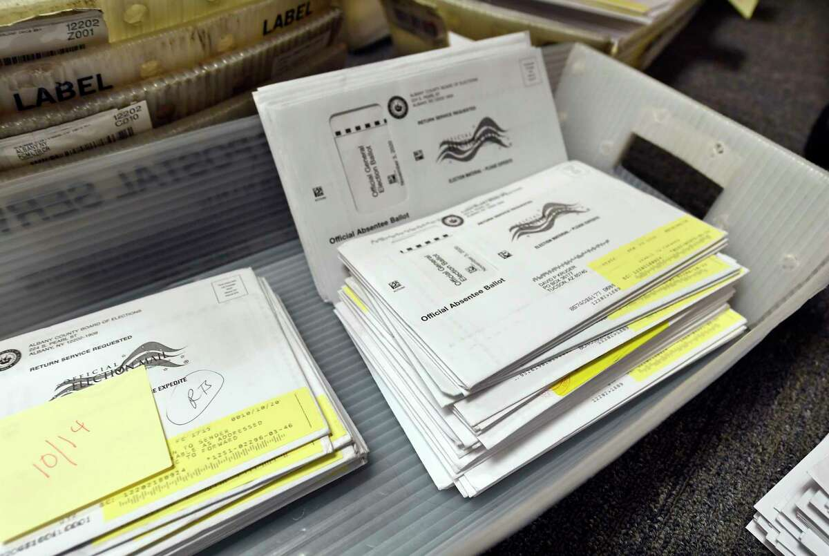 FILE. Sorted Absentee Ballots needing voter corrections at the Albany County Board of Elections building Wednesday, Oct. 14, 2020, in Albany, N.Y.