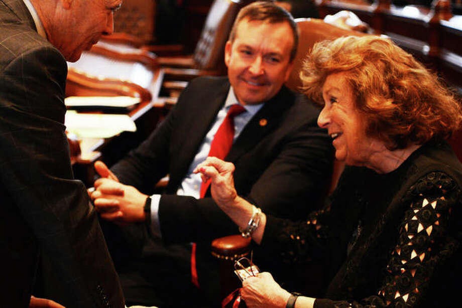 In this file photo, then-state Sen. Deanna Demuzio, D-Carlinville, foreground, is shown during a General Assembly session in Springfield with current state Sen. Andy Manar, D-Bunker Hill, center, listening in the background. Photo: Courtesy Of Senatorandymanar.com|For The Telegraph