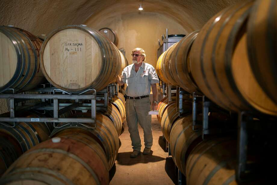 Kaj Ahlmann stands among barrels of wine at Six Sigma Ranch and Winery in Lower Lake (Lake County). Photo: Santiago Mejia / The Chronicle