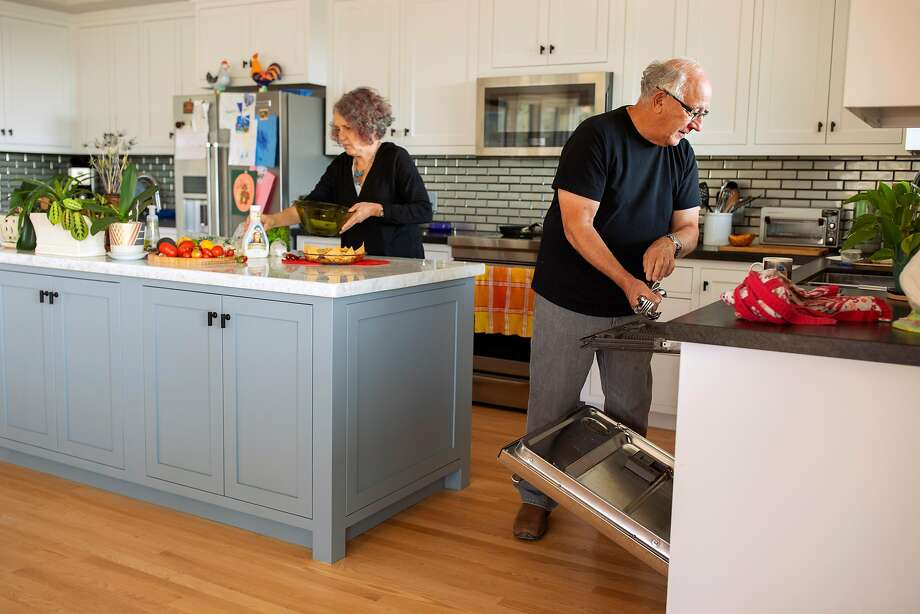 Marlena and Barry Hirsch work in their home in Santa Rosa they rebuilt with fire-resistant materials after the Tubbs Fire. Photo: Santiago Mejia / The Chronicle